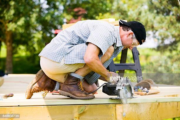 Man Cutting Into Deck