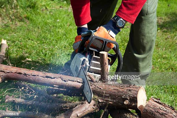 Man cutting logs with chainsaw
