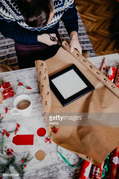 Man cutting wrapping paper