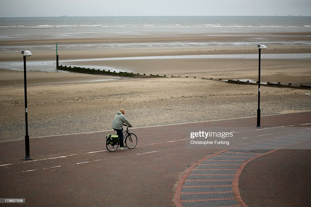 A man cycles along Rhyl Promenade on August 5, 2013 in Rhyl, Wales. The think tank The Centre for Social Justice (CSJ) has today said that some British seaside towns such as Rhyl in North Wales were becoming 'dumping grounds' for vulnerable people. The report 'Turning the Tide' has monitored conditions in five seaside towns, Rhyl in Denbighshire, Margate in Kent, Clacton-on-Sea in Essex, Blackpool in Lancashire and Great Yarmouth in Norfolk. In one area of Rhyl, over 66% of working-age people were found to be dependent on out-of-work benefits.