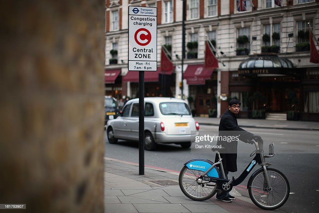 A man cycles past a congestion charge sign in Victoria on February 15, 2013 in London, England. The weekday charge was introduced by the then Mayor of London Ken Livingstone on February 17, 2003 and celebrates its tenth anniversary on Sunday. Originally costing 5 GBP it has risen over the years to its current price of 10 GBP.