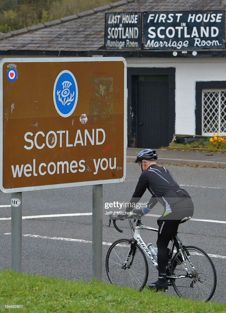 A man cycles past a welcome to Scotland sign on October 22, 2012 in Gretna, Scotland. Last week Scottish First Minister Alex Salmond met with British Prime Minister David Cameron and agreed on details for a Scottish independence referendum to be held in the autumn of 2014 asking a single yes or no question on whether the country should become independent.