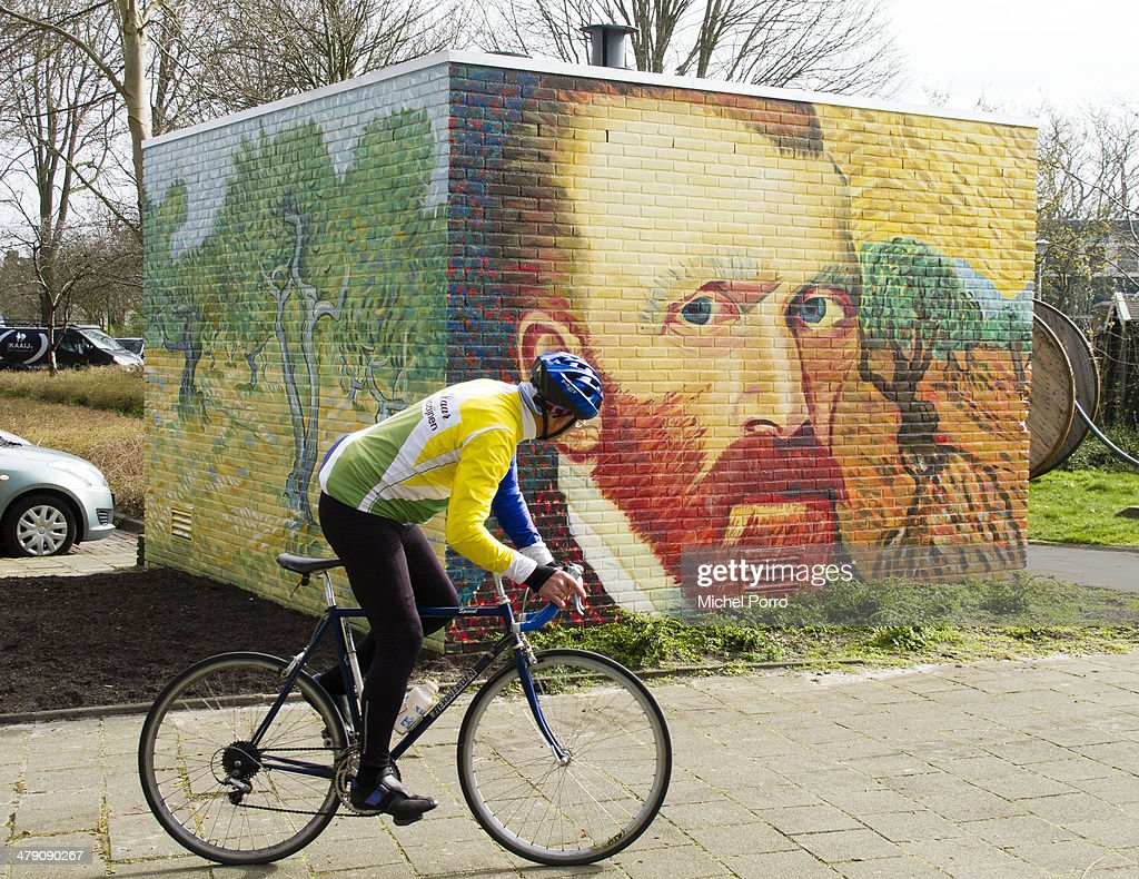 A man cycles past an electricity power substation decorated with replica's of original paintings by Vincent Van Gogh on March 16, 2014 in Wassenaar, Netherlands. The Van Gogh Europe Foundation announced that in the year 2015 exhibitions will be organized to commemorate the 125th anniversary of his death.