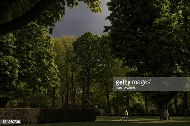 A man cycles through a park on April 28 2017 in Brussels Belgium The 27 members of the European Union will meet in Brussels tomorrow for a special...