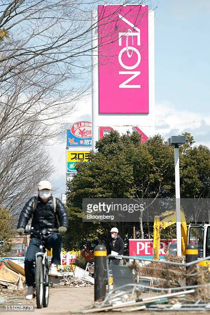A man cycles through the debris from the March 11 earthquake and tsunami near an Aeon Co shopping center in Tagajo City Miyagi Prefecture Japan on...