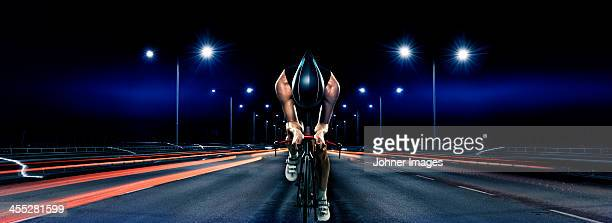 Man cycling at night