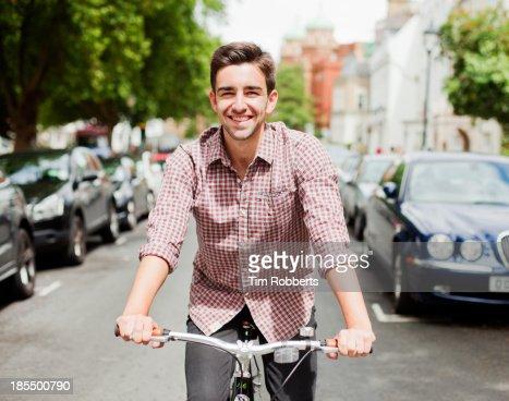 Man cycling down a street.