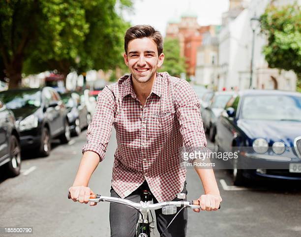 Man cycling down a street.