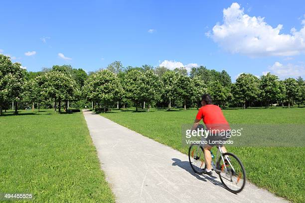 A Man Cycling in the park