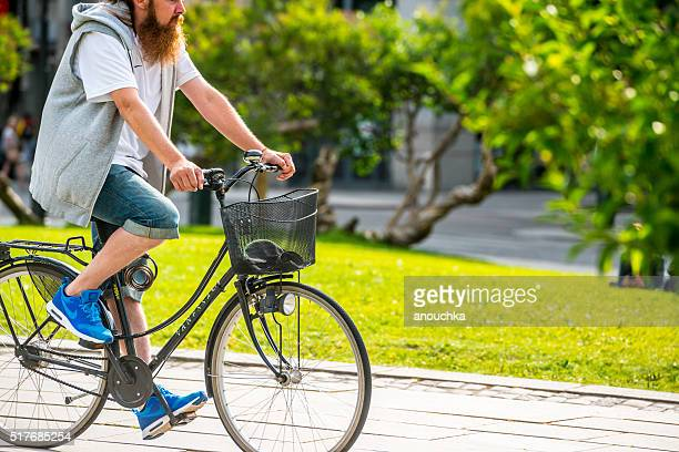 Man cycling on Oslo street, Norway