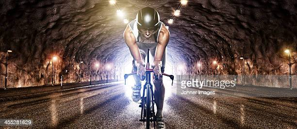Man cycling through tunnel
