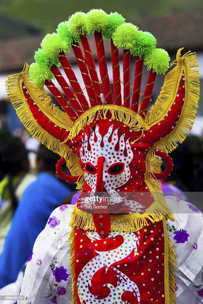 """A man dancer in a colorful costume performs Aya Uma, the creature from the Indian myths, during the Inti Raymi celebration in the village on 26 June 2010 in Olmedo, Ecuador. Inti Raymi, """"Festival of the Sun"""" in Quechua language, is an ancient spiritual ceremony held in the Indian regions of the Andes, mainly in Ecuador and Peru. The lively celebration, set by the winter solstice, goes on for various days. The highland Indians, wearing beautiful costumes, dance, drink and sing with no rest. Colorful processions in honor of the God Inti (Sun) pass through the mountain villages giving thanks for the harvest and expressing their deep relation to the Mother Earth (Pachamama)."""