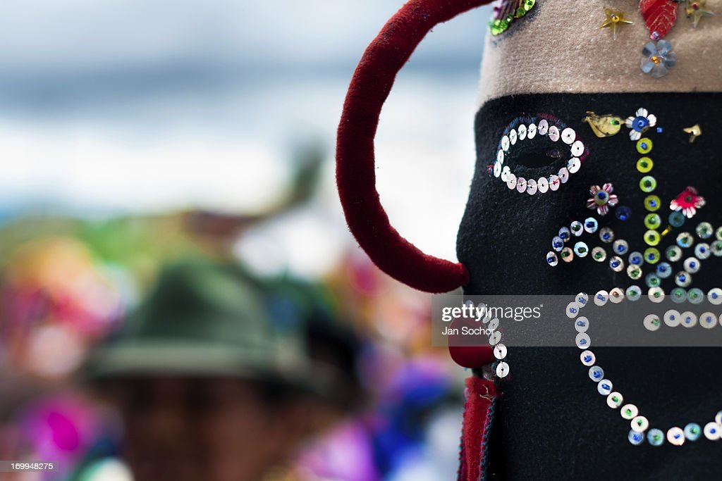 """A man dancer, wearing a colorful masque, performs Aya Uma - the creature from the Indian myths, during the Inti Raymi festival on 26 June 2010 in the village of Pesillo, Ecuador. Inti Raymi, """"Festival of the Sun"""" in Quechua language, is an ancient spiritual ceremony held in the Indian regions of the Andes, mainly in Ecuador and Peru. The lively celebration, set by the winter solstice, goes on for various days. The highland Indians, wearing beautiful costumes, dance, drink and sing with no rest. Colorful processions in honor of the God Inti (Sun) pass through the mountain villages giving thanks for the harvest and expressing their deep relation to the Mother Earth (Pachamama)."""