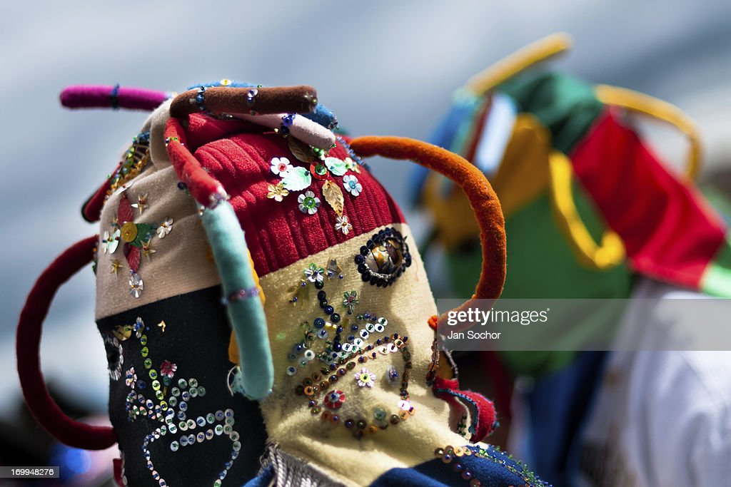 """A man dancer, wearing a colorful masque, performs Aya Uma - the creature from the Indian myths, during the Inti Raymi fiesta in the village of Pesillo, Ecuador, 26 June 2010. Inti Raymi, """"Festival of the Sun"""" in Quechua language, is an ancient spiritual ceremony held in the Indian regions of the Andes, mainly in Ecuador and Peru. The lively celebration, set by the winter solstice, goes on for various days. The highland Indians, wearing beautiful costumes, dance, drink and sing with no rest. Colorful processions in honor of the God Inti (Sun) pass through the mountain villages giving thanks for the harvest and expressing their deep relation to the Mother Earth (Pachamama)."""