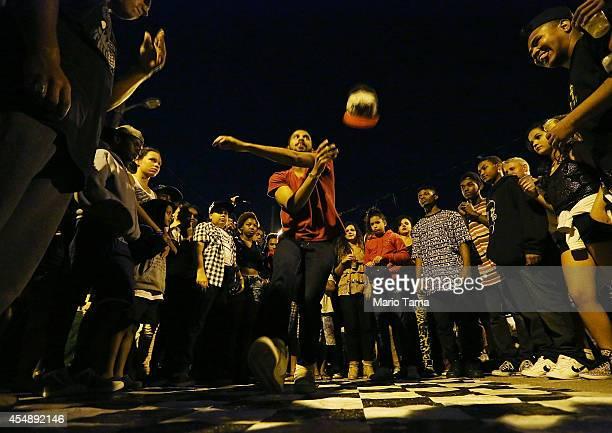 A man dances at a street party in the Prazeres favela on September 7 2014 in Rio de Janeiro Brazil Rio de Janeiro's government aims to revitalize all...