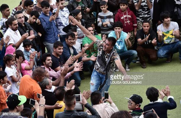 TOPSHOT A man dances during the celebrations of Nauroz 'New day' the traditional Afghan New Year's Day on March 21 2017 at the Hockey refugee camp...