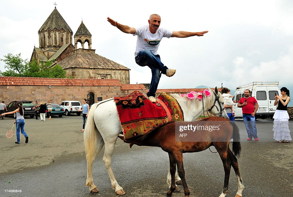 A man dances on a horse in front of 13th century's St.John Cathedral in Gandzasar monastery about 45 km from city of Stepanokert in Armenian-controlled Azerbaijani region of Nagorny Karabakh on June 27, 2013. A growing number of foreign tourists are heading to the breakaway territory -- which is not recognised by any state -- and say they are seeing a different side to its war-scarred image. Wandering around the region's largest town Stepanakert as part of a tour group whose members come from places ranging from Turin to Taiwan, French chemist Jordan Nahoum said that while he knew all about Nagorny Karabakh's bloody past, he was surprised by what he found