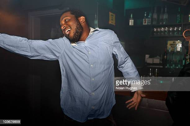 man dancing at bar