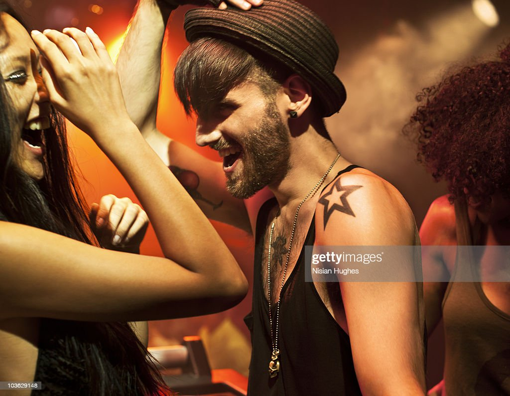 Man Dancing having fun with woman in nightclub : Stock Photo
