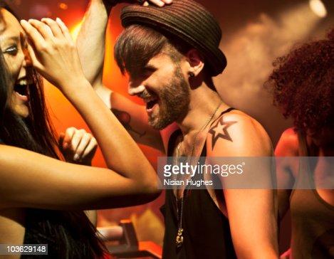 Man Dancing having fun with woman in nightclub : Stock Photo