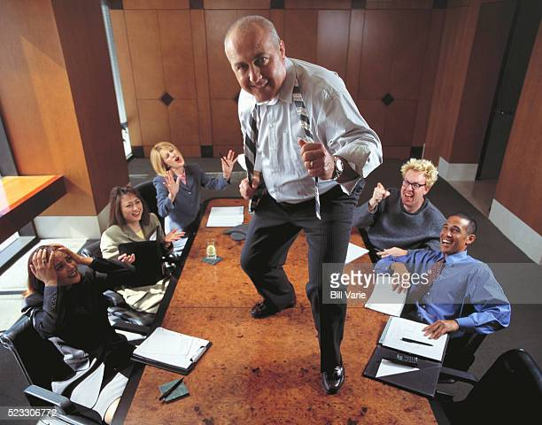 Man Dancing on Conference Room Table