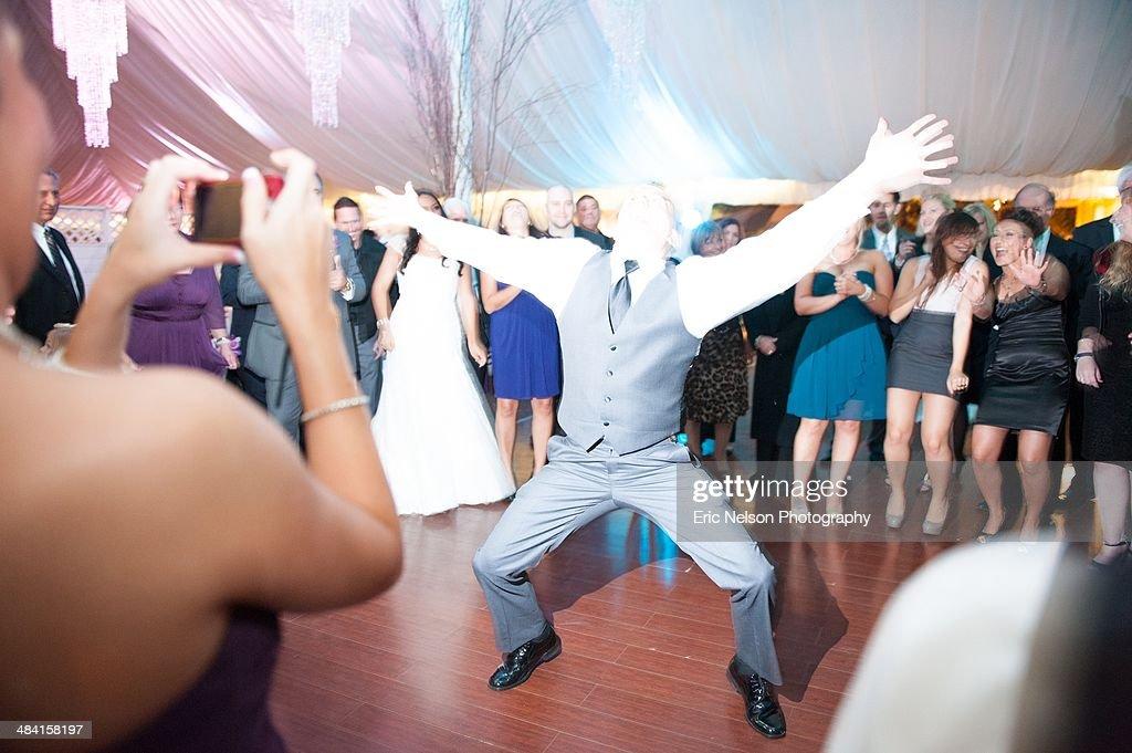 Man dancing solo at wedding reception