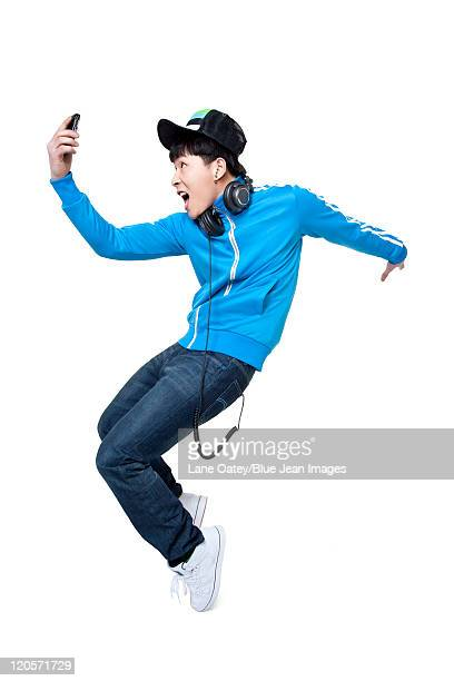 Man dancing while holding up his phone