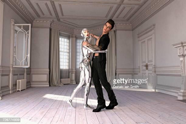 Man dancing with woman robot