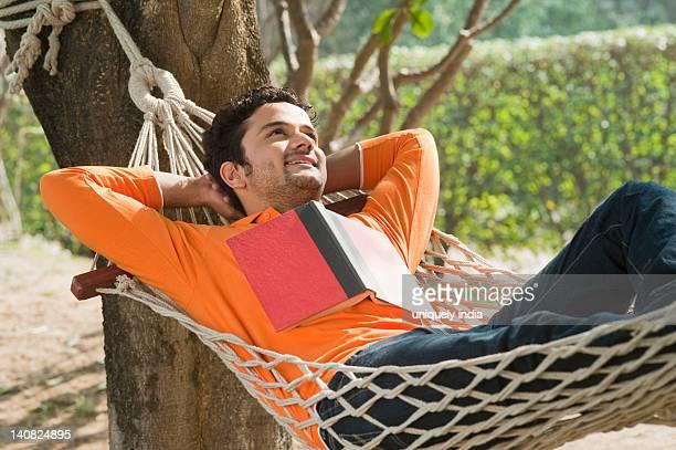 Man day dreaming in a hammock