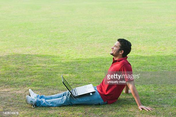 Man day dreaming with a laptop