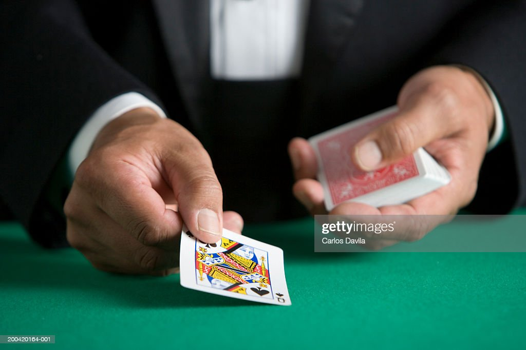 Man dealing deck of cards, close-up : Stock Photo