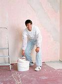 Man decorating a room