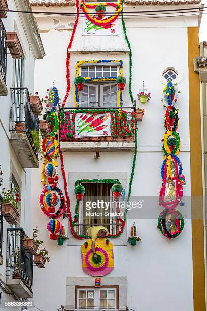 Man decorating house in Alfama