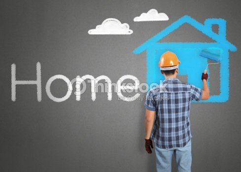 Man Decorating Or Painting House Stock Photo | Thinkstock