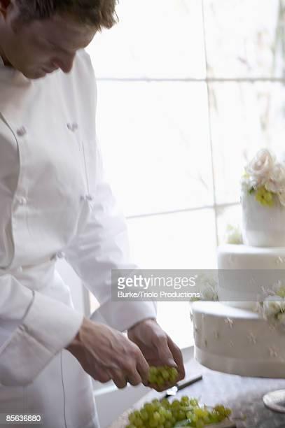 Man decorating wedding cake