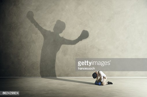 man defeated by his shadow boxing : Stock Photo