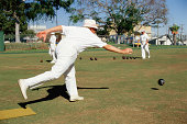 Man delivering ball in lawn bowling