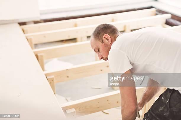 Man demolishing and rebuilding