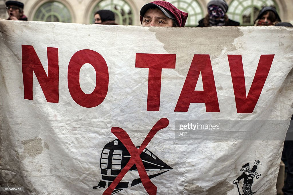 A man demonstrates against the new LGV Lyon-Turin project, on December 3, 2012 in Lyon, on the sideline of the 30th France-Italy annual summit.