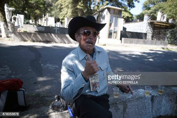 A man depicted Mexican singer and actor Pedro Infante sings during the 100th Anniversary of his birth at the Panteon Jardin in Mexico City on...