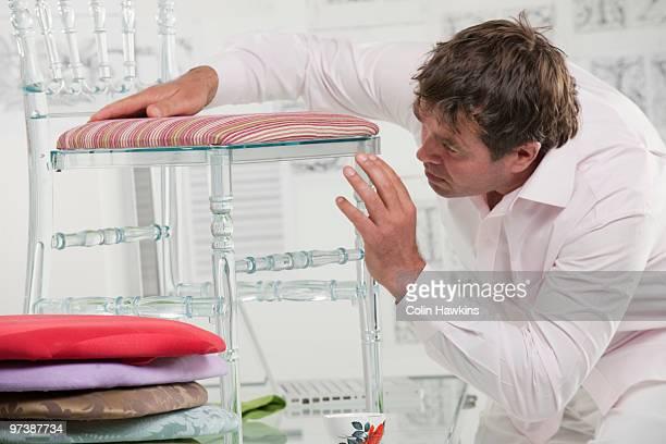 man designing furniture