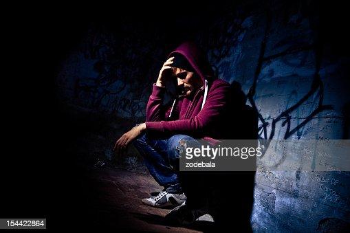 Man Desperate and Alone in Dark Alley : Stock Photo