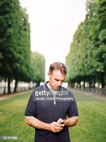 Man dialing on his mobile phone : Stock Photo