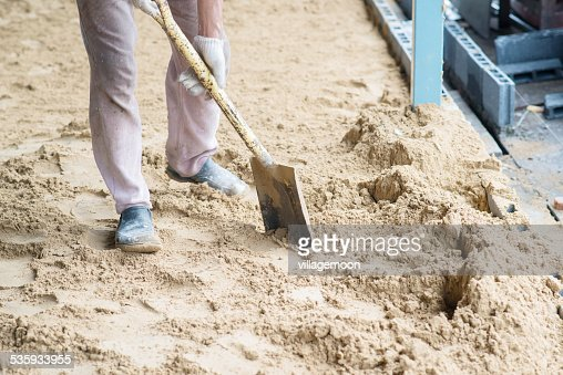 man digging in the ground with shovel and spade : Stock Photo