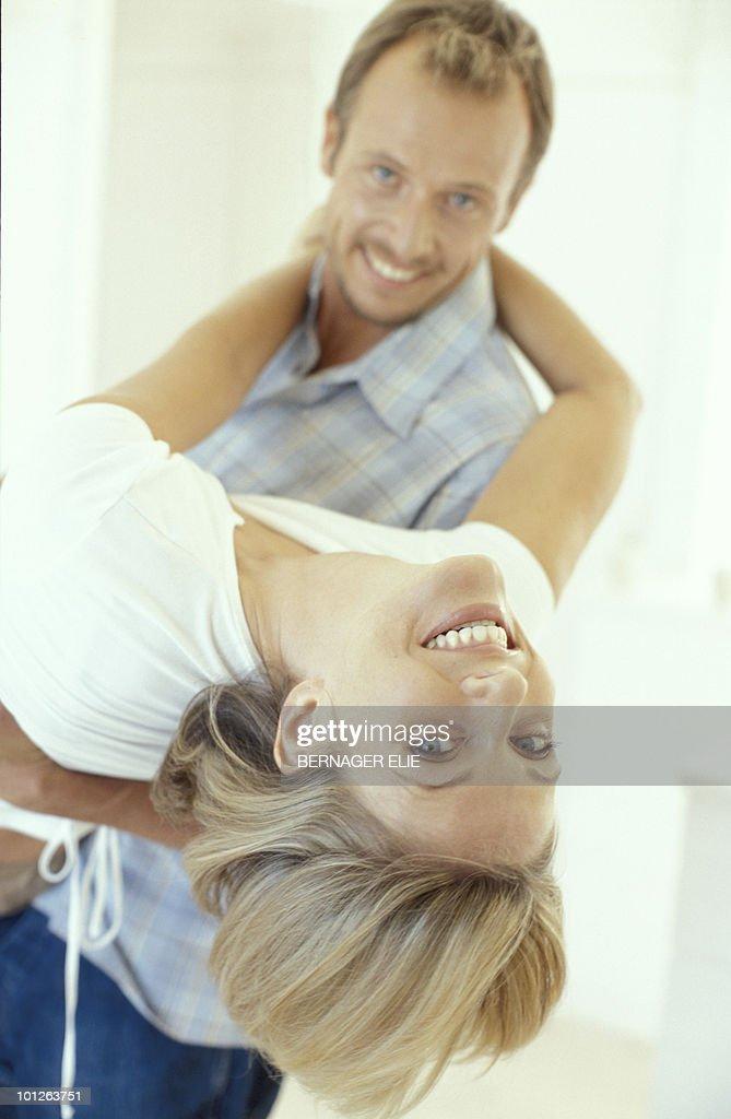 Man dipping woman : Stock Photo