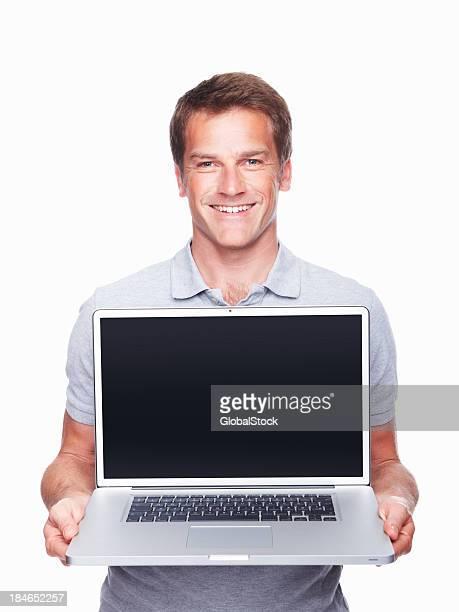 Man displaying laptop