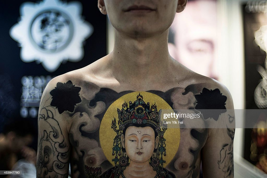 A man displays his tattoo at the Hong Kong Tattoo Convention on August 22, 2014. in Hong Kong. The 2nd International Hong Kong Tattoo Convention 2014 features tattoo artists from around the world.