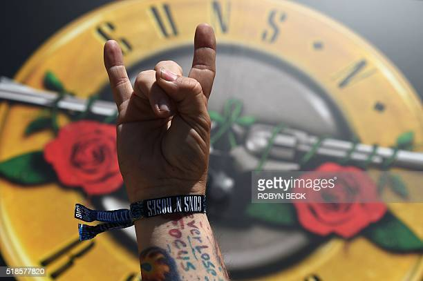 A man displays his wristband to attend tonight's surprise Guns N' Roses show outside the Tower Records building on the Sunset Strip April 1 in West...
