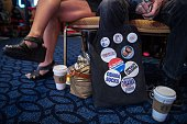 A man displays pins as he attends the annual Conservative Political Action Conference at National Harbor Maryland outside Washington DC on February...