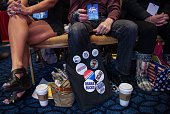 A man displays pins as he attends the annual Conservative Political Action Conference at National Harbor Maryland outside WashingtonDC on February 26...